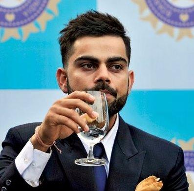 Virat Kohli having champagne