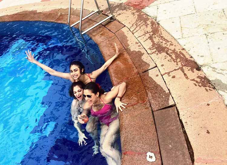 Mouni Roy chilling with her friends in the pool