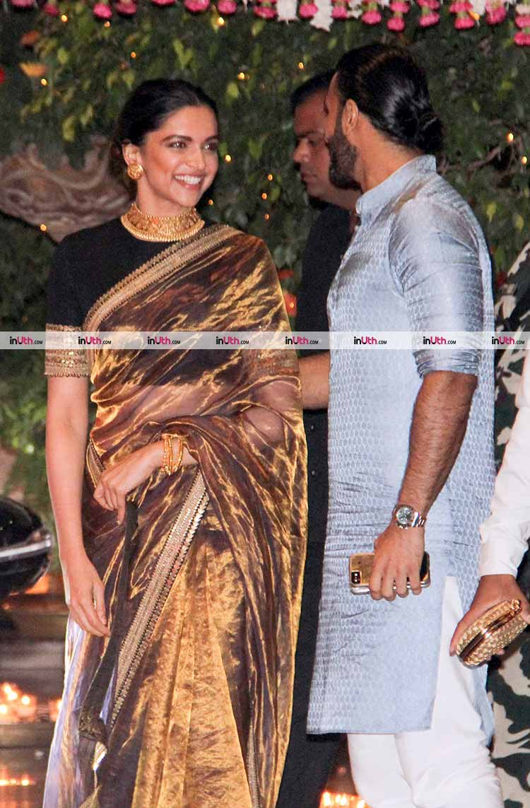 Deepika Padukone and Ranveer Singh share a light moment at Ambani's party