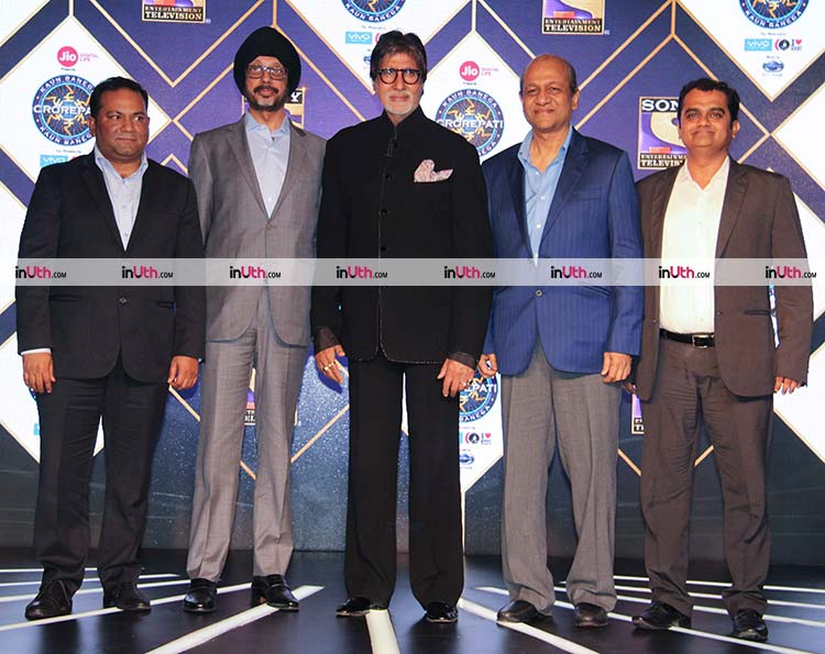 Amitabh Bachchan, NP Singh, and Siddharth Basu at Kaun Banega Crorepati season 9