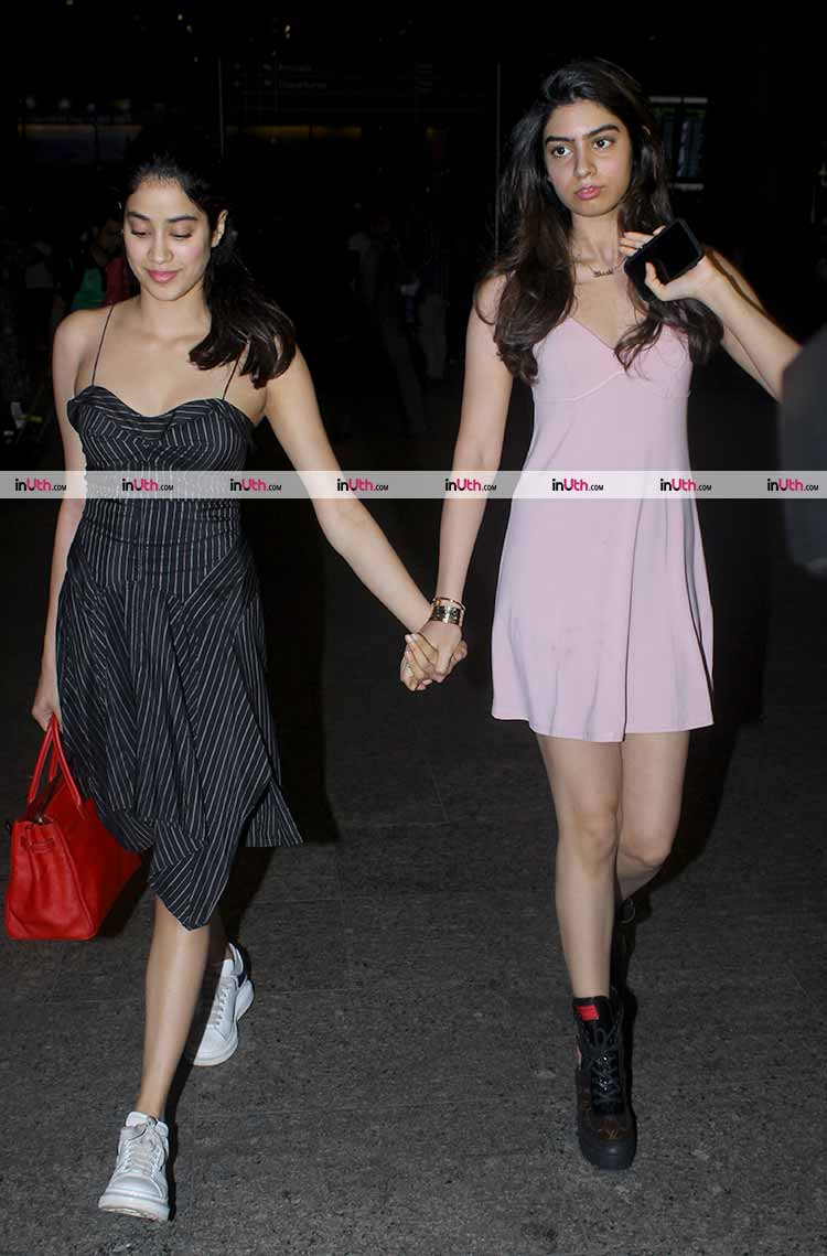 Jhanvi and Khushi Kapoor walking hand-in-hand at the airport