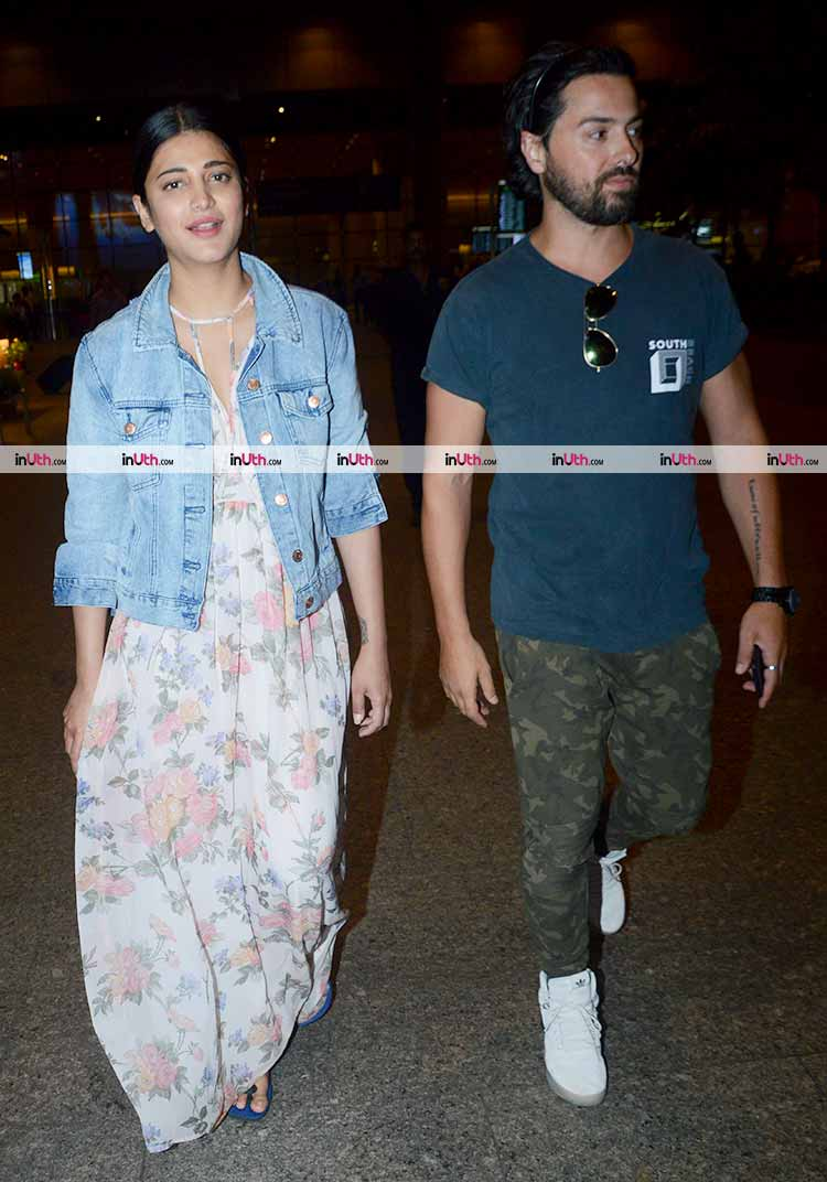 Shruti Haasan at the airport with boyfriend Michael Corsale