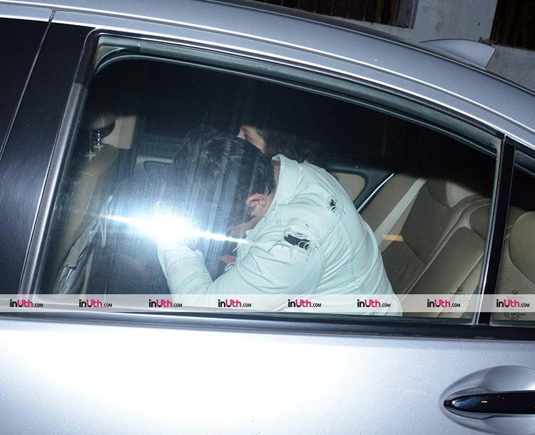 Aarav trying to hide his face from the shutterbugs