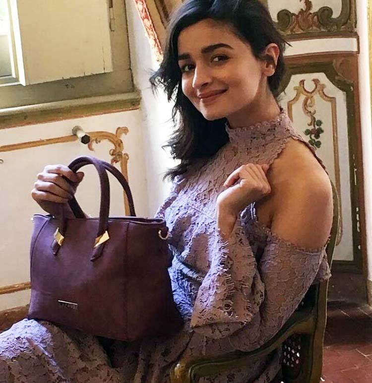 Alia Bhatt posing with her favourite Caprese bag