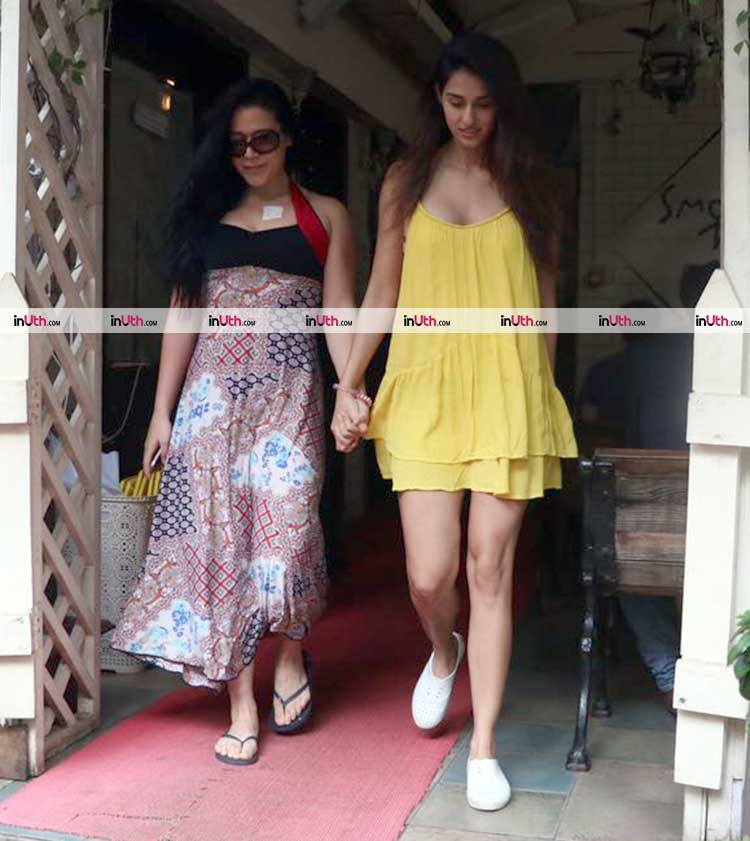 Disha Patani and Krishna Shroff walk out of the cafe holding hands