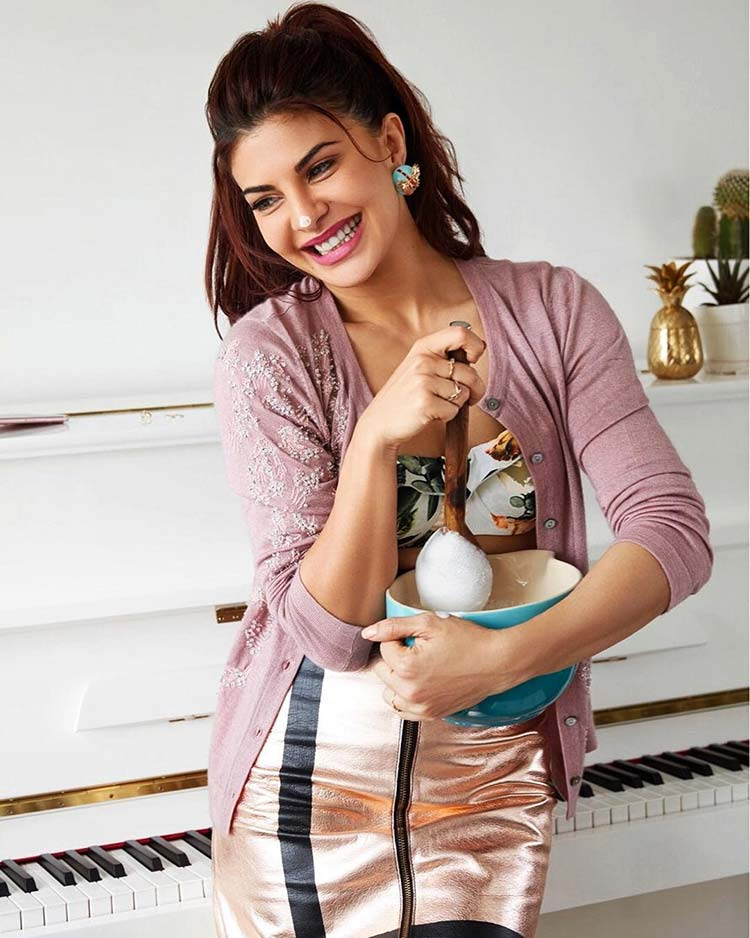 Jacqueline Fernandez whisking dreams in her pot