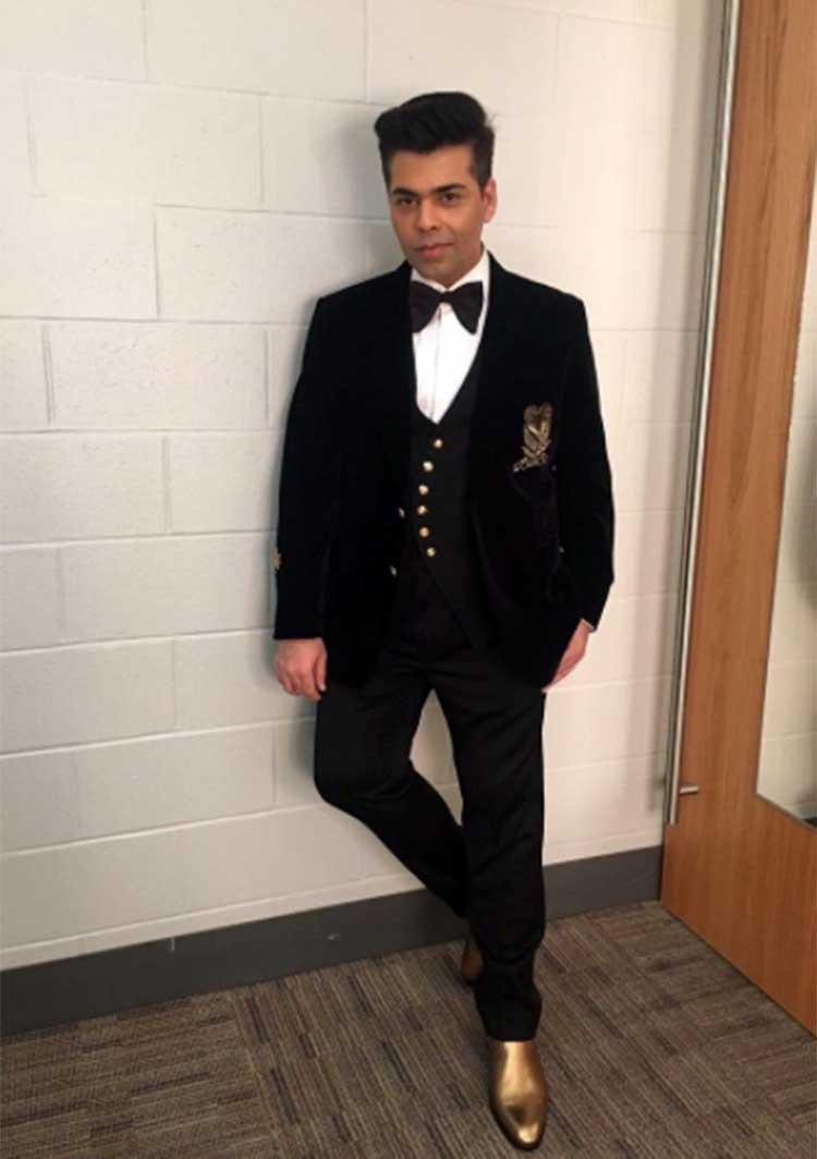 Karan Johar has his own way of carrying the golden boots