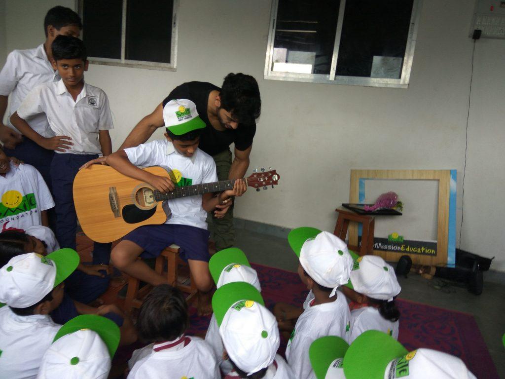 Taaha Shah with kids at an NGO