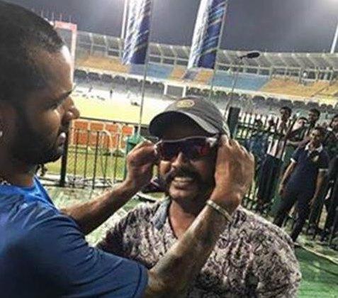 Dhawan gifts fan