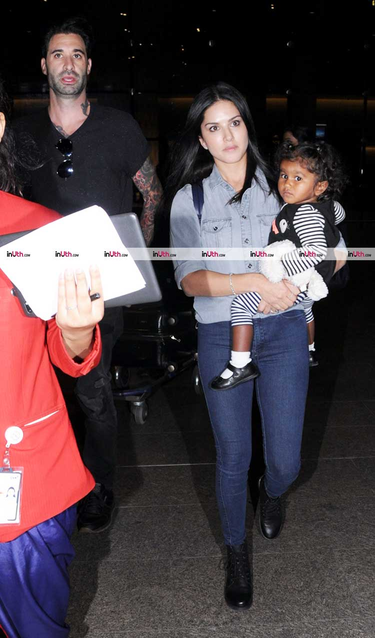 Sunny Leone spotted exiting the Mumbai airport with husband and daughter