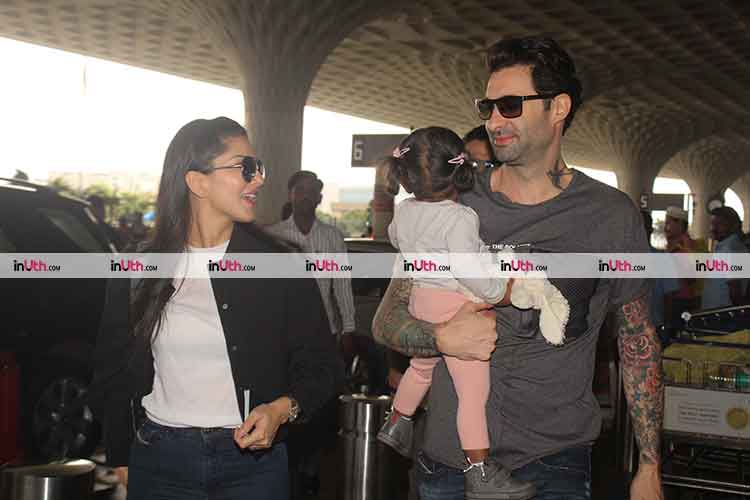 Sunny Leone spotted with husband and daughter at the Mumbai airport