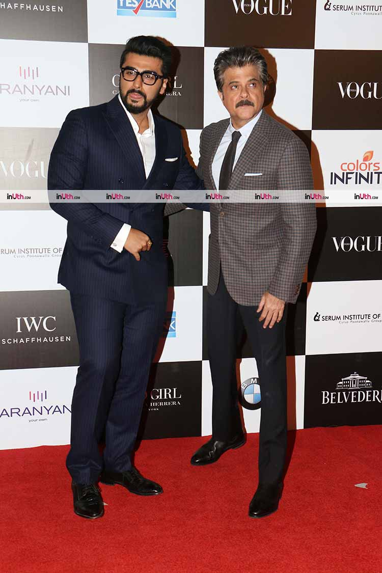 Arjun and Anil Kapoor pose for the shutterbugs on the Vogue red carpet