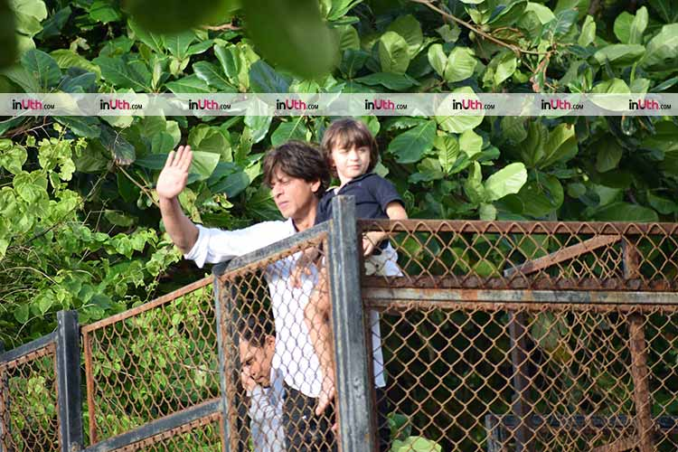 Shah Rukh Khan and AbRam greeting their fans