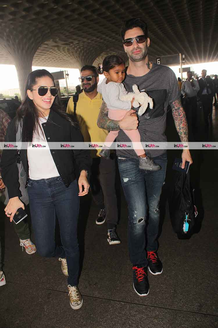Sunny Leone and Daniel Weber catch a flight with daughter Nisha