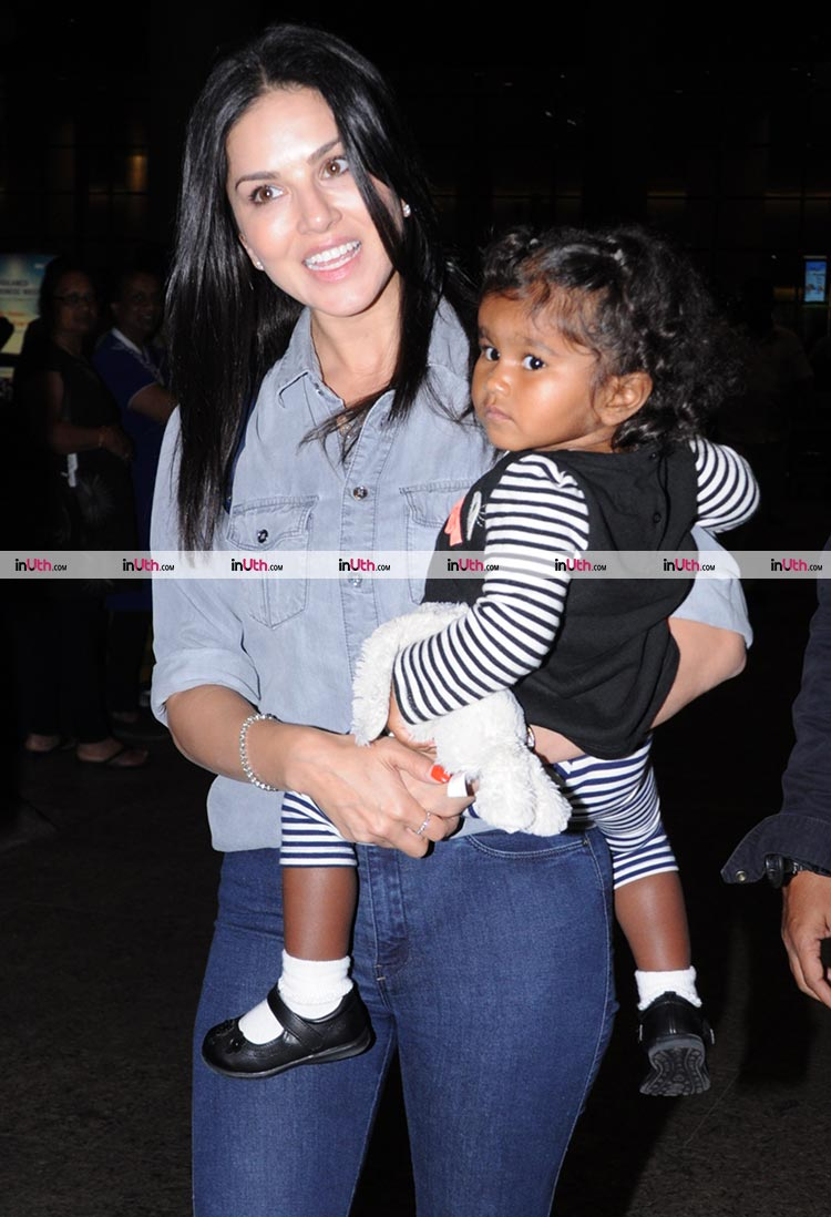 Sunny Leone with daughter Nisha at the Mumbai airport on Thursday night