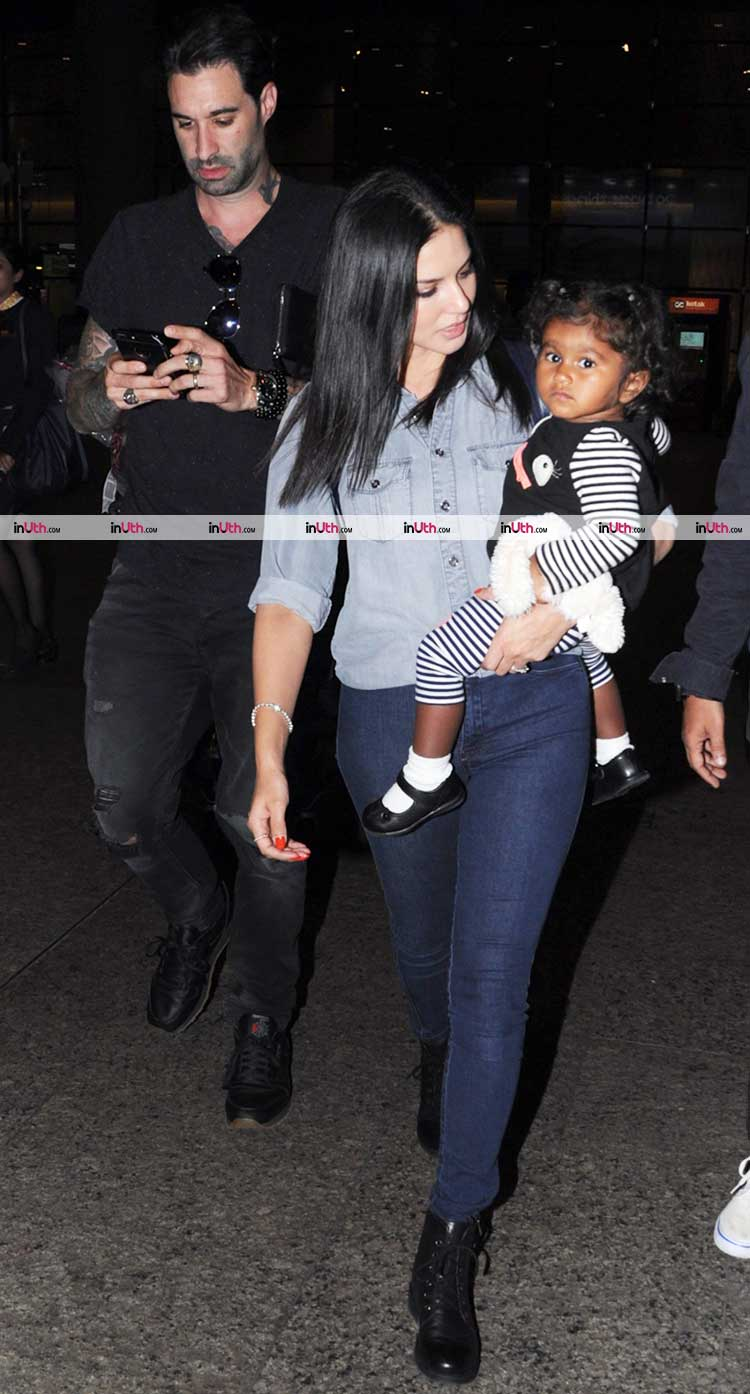 Sunny Leone and Daniel Weber clicked at the airport with cute Nisha