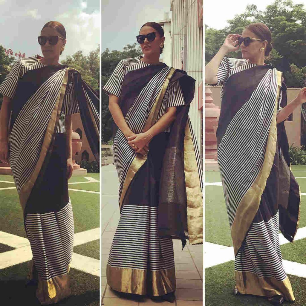 Neha Dhupia in a monochrome striped saree from Raw Mango
