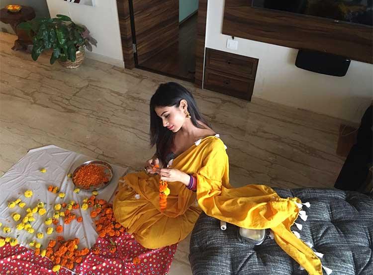 Mouni Roy making phool-mala for Diwali