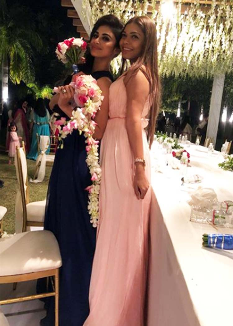 Mouni Roy posing with a friend at Aashka Goradia's wedding