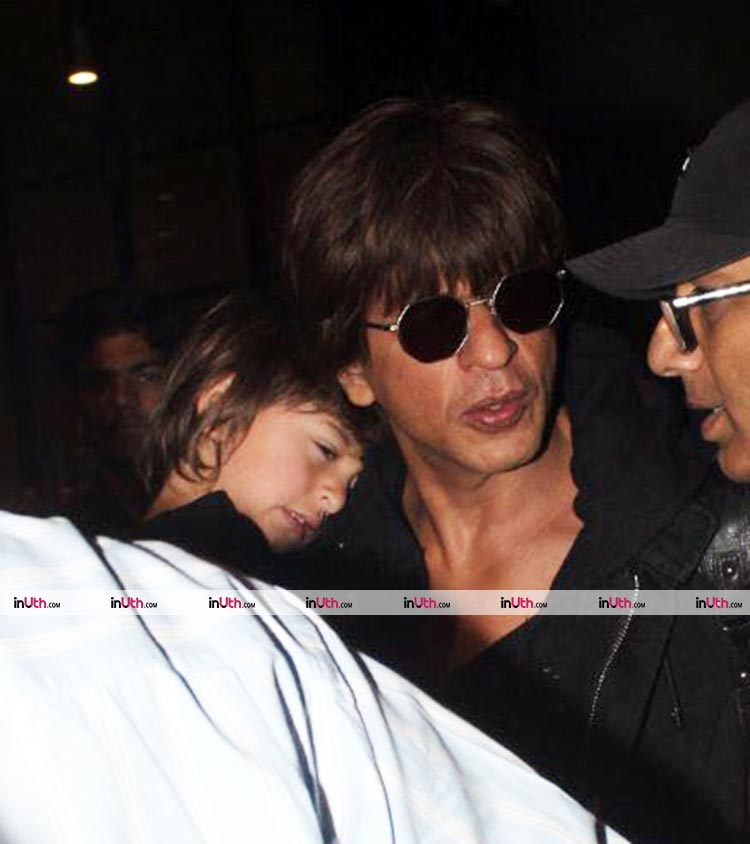 AbRam spotted sleeping on dad Shah Rukh's shoulder at the airport