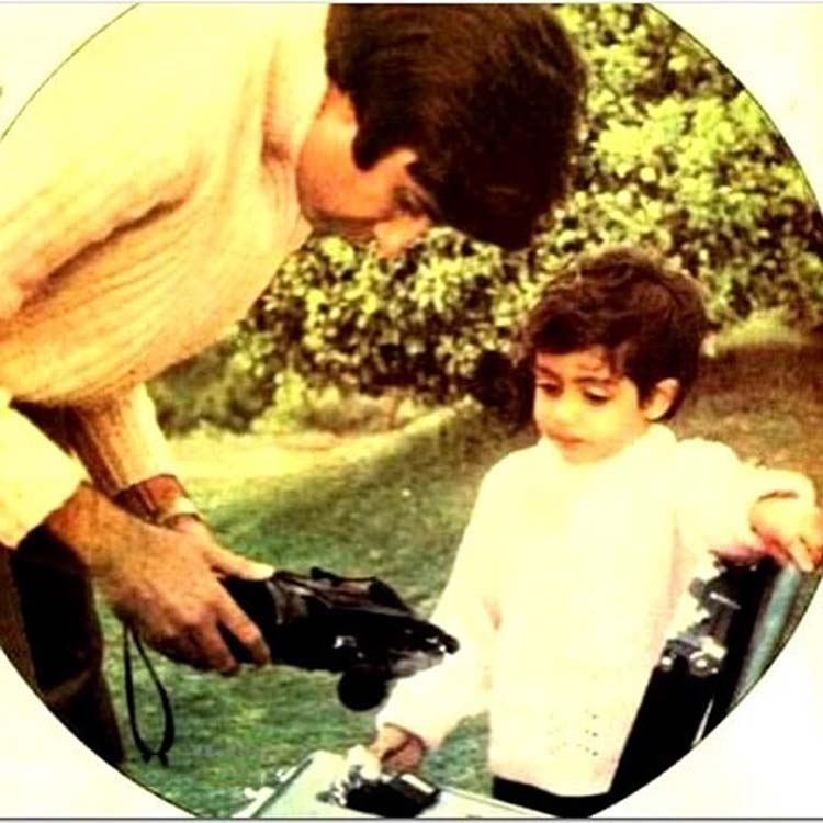 Amitabh Bachchan playing with his son Abhishek Bachchan