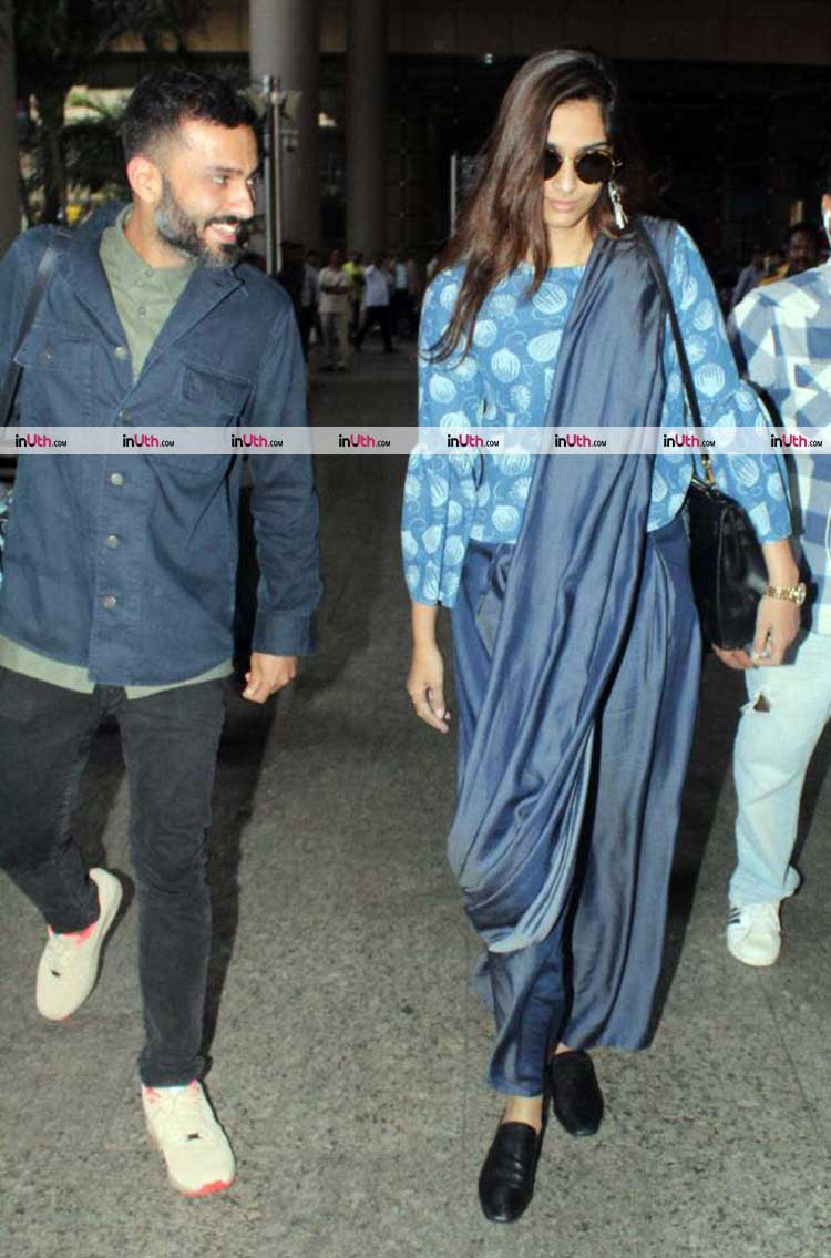 Anand Anuja and Sonam Kapoor walking out of the Mumbai airport