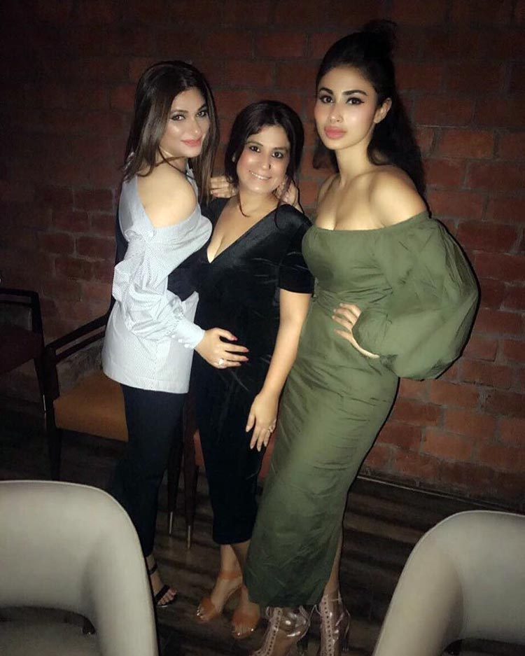 Mouni Roy with the birthday girl at a party