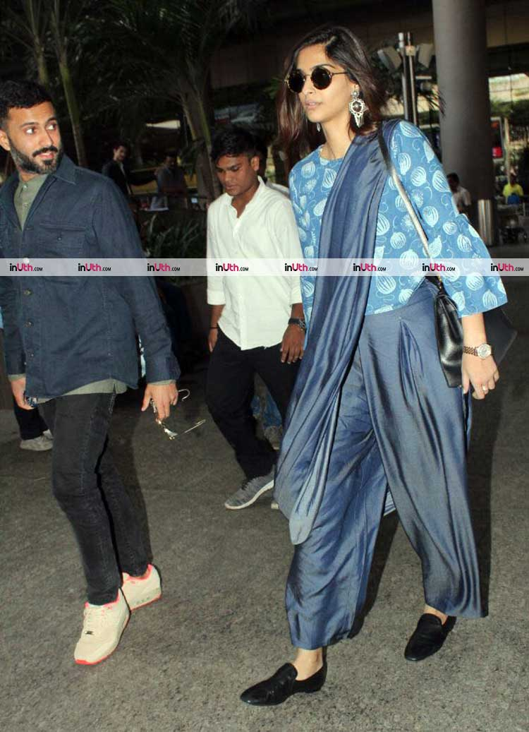 Anand Ahuja with Sonam Kapoor at Mumbai airport
