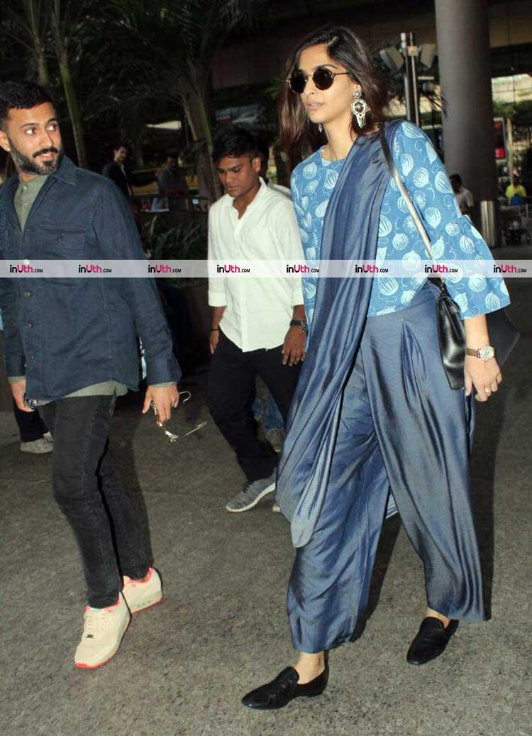 Anand Ahuja with Sonam Kapoor at Mumbai airport