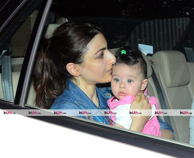 Soha planting a kiss on Inaaya's forehead
