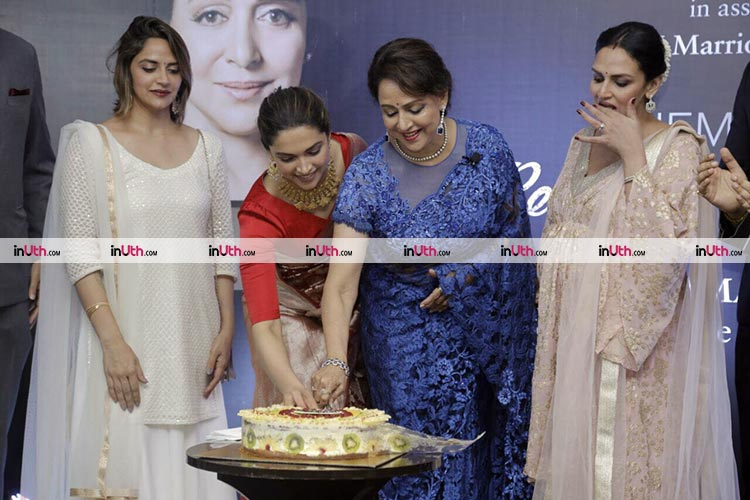 Hema Malini cutting the cake at her biography launch