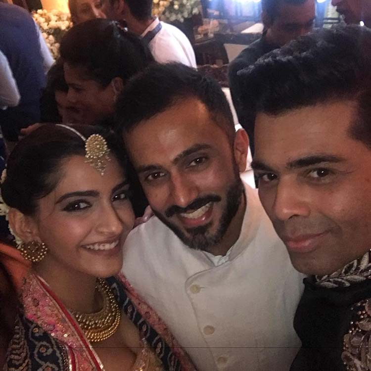 Sonam Kapoor and Anand Ahuja with Karan Johar