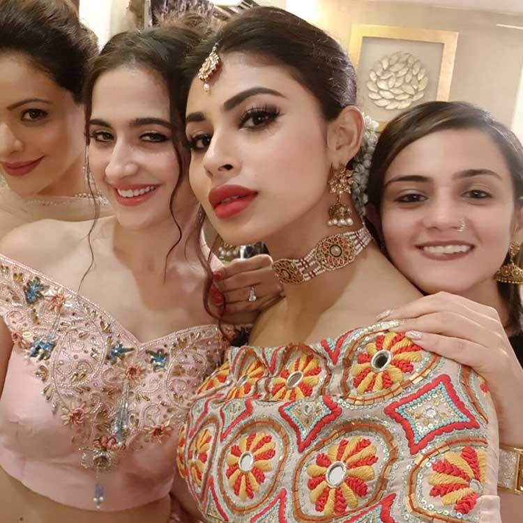 Mouni Roy posing for a selfie with her friends