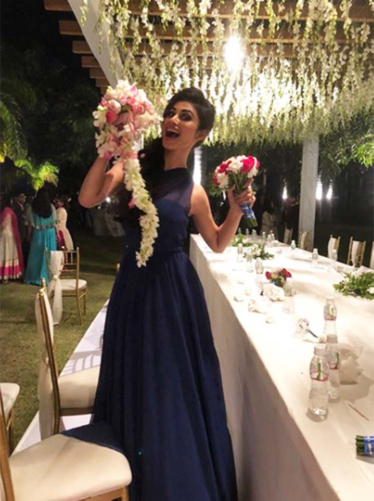 Mouni Roy caught Aashka Goradia's bouquet at the wedding