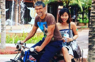 Milind Soman with his girlfriend photo