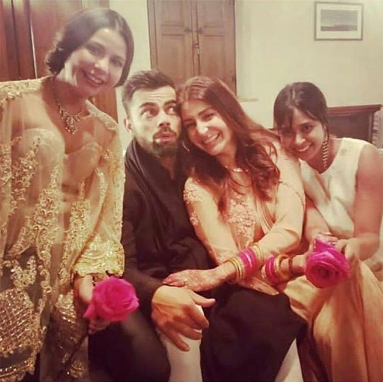 Virat Kohli and Anushka Sharma with their friends during a post-wedding function