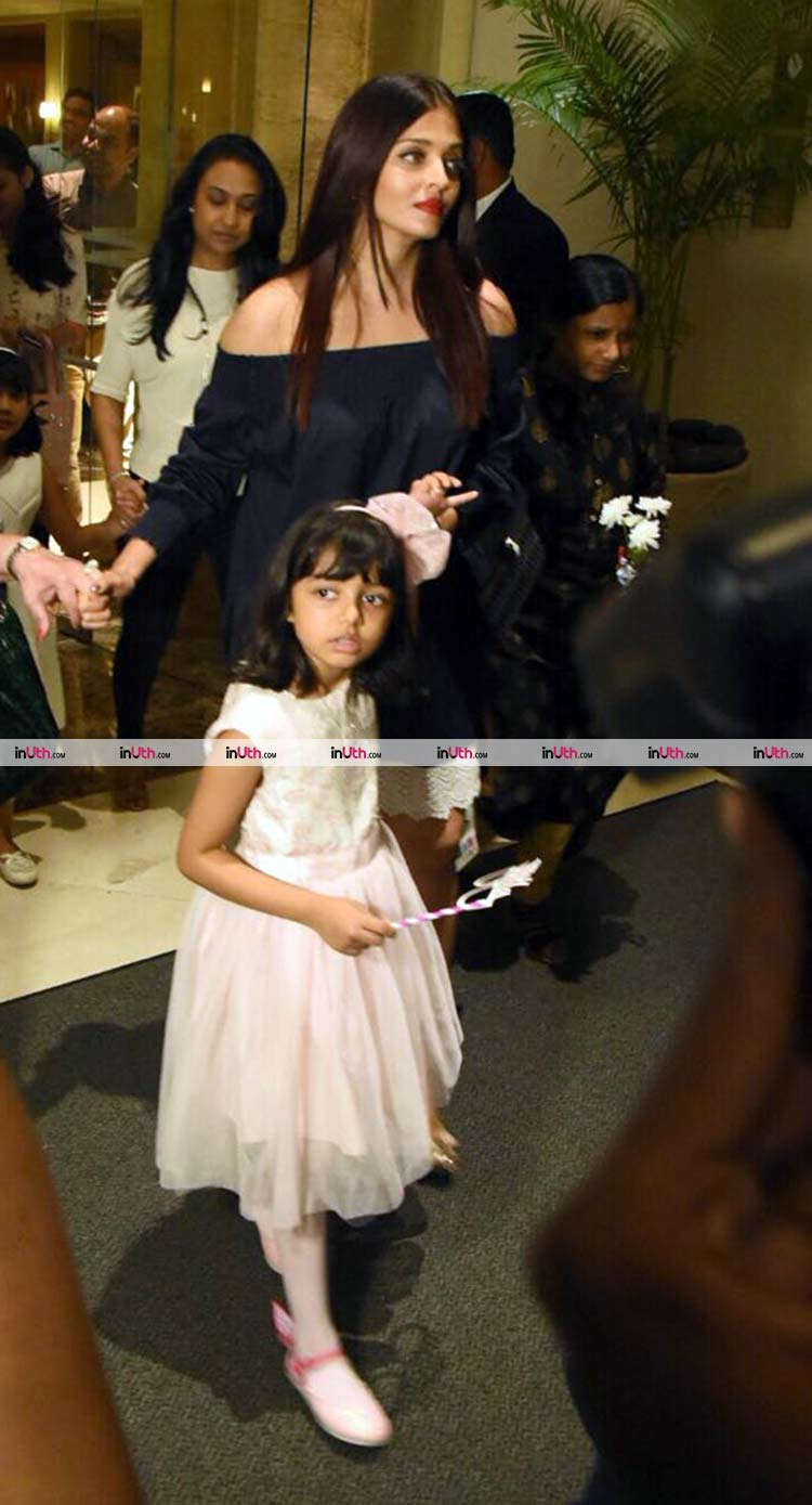 Aishwarya Rai and Aaradhya Bachchan reaching for the latter's birthday party