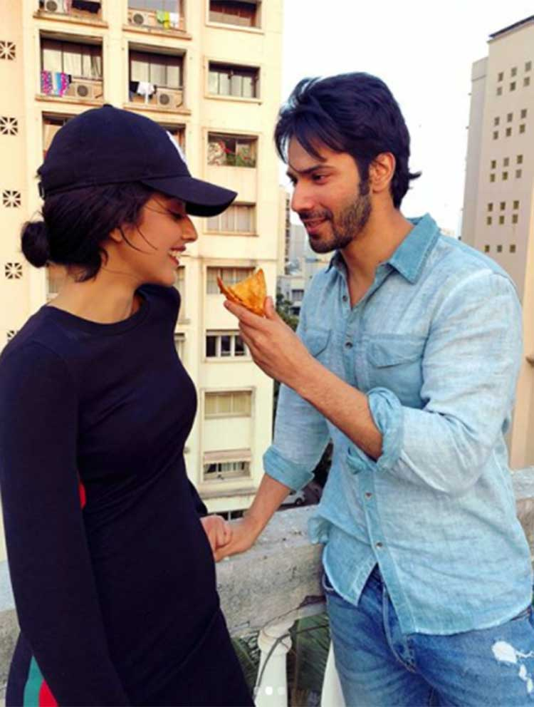 Varun Dhawan offering samosa to Banita Sandhu on October sets
