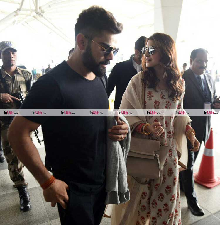 Virat Kohli with Anushka Sharma at the Mumbai airport