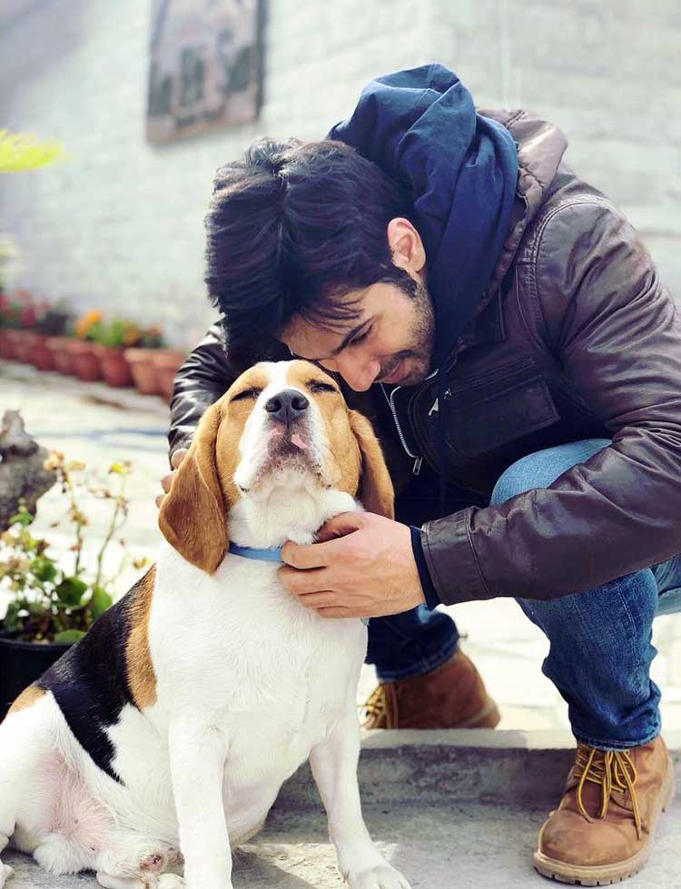 Varun Dhawan with his canine friend on the sets of October