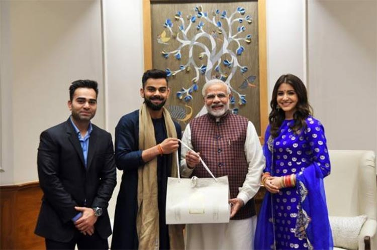 Virat Kohli and Anushka Sharma with PM Narendra Modi