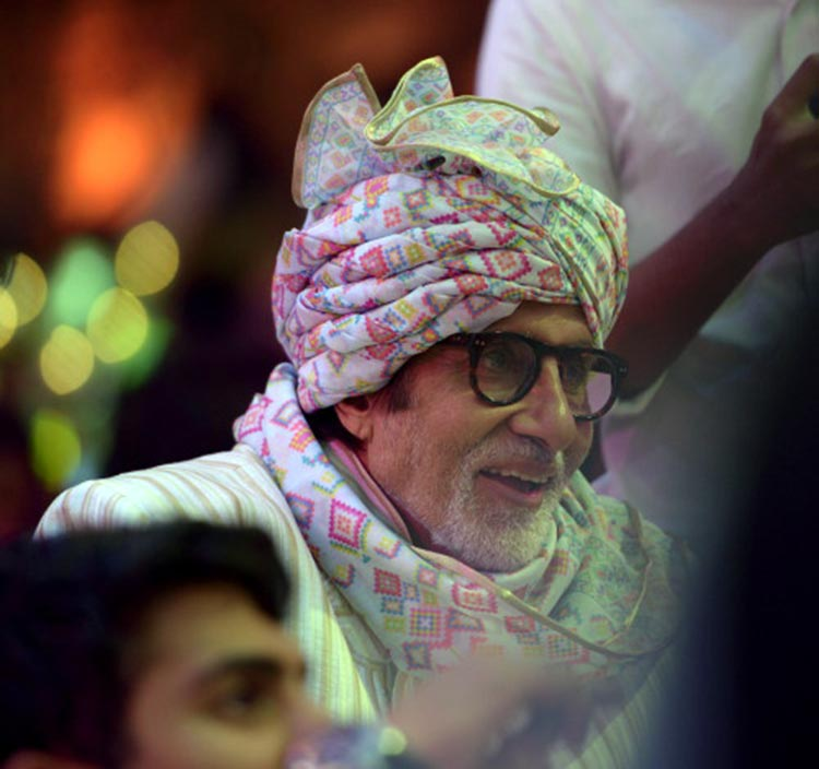 Amitabh Bachchan caught candid at a family wedding