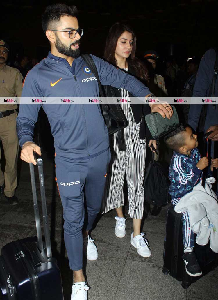 Virat Kohli and Anushka Sharma with Zoravar at Mumbai airport