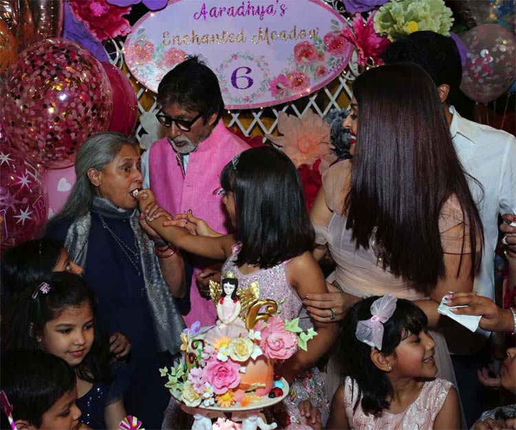 Aaradhya Bachchan serving birthday cake to grandmother Jaya Bachchan