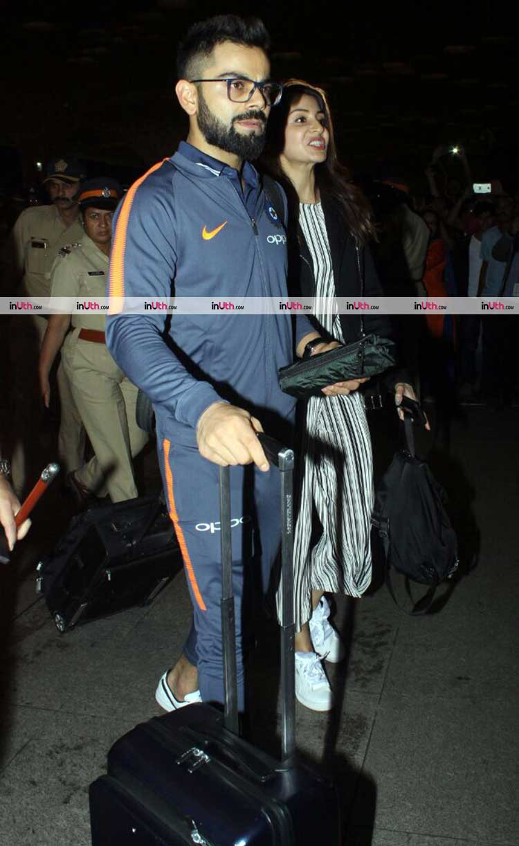Virat Kohli with wife Anushka Sharma at the airport