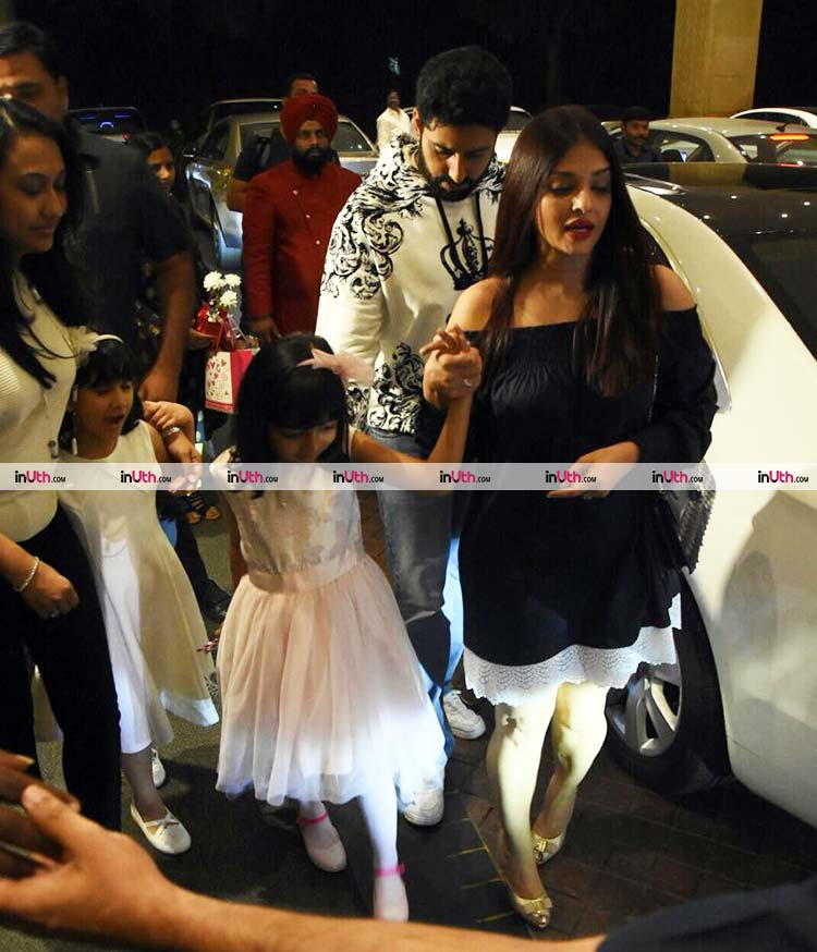 Aishwarya and Abhishek taking Aaradhya for her birthday party