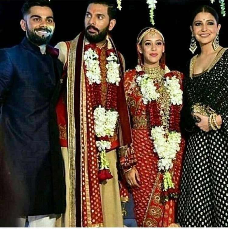 Virat Kohli and Anushka Sharma at the wedding of Yuvraj Singh