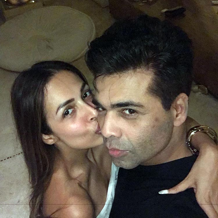 Karan Johar and Malaika Aroa at Shah Rukh Khan's birthday bash