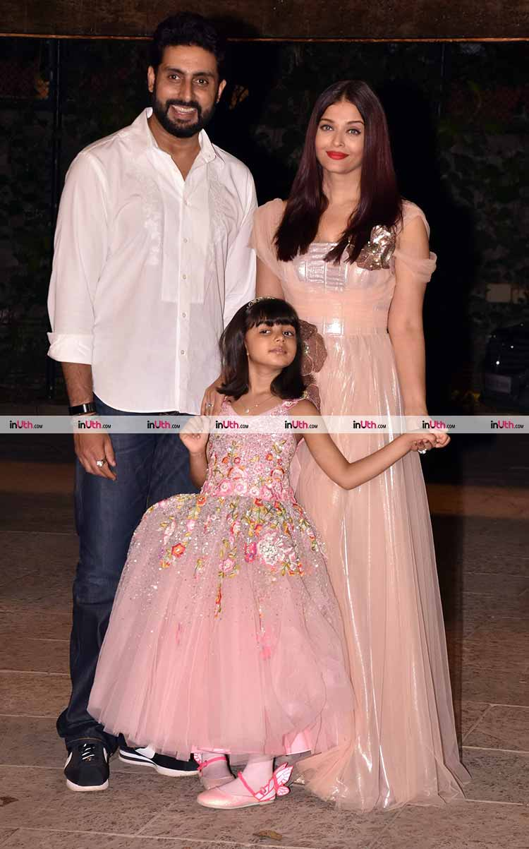Aaradhya Bachchan posing with Abhishek Bachchan and Aishwarya Rai