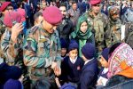 Lt Col (Hony) MS Dhoni pays surprise visit to Srinagar School, interacts with his little fans – SEE PICS